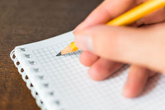 Written in the notebook, close up view Stock Photos