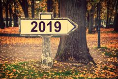 2019 written on an old french roadsign. Fall background stock photography
