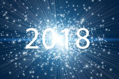 2018 written over lights and sparks background. New year 2018 text written over blue abstract lights and sparks background Royalty Free Stock Image