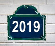 2019 written on a Paris street plate on white wall. 2019 written on a Paris street plate isolated on white brick wall royalty free stock photos