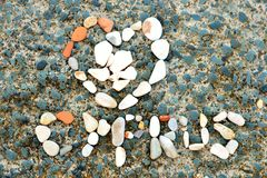 Written pattern of sea shells and stones on rock Royalty Free Stock Images