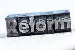 Written reform in lead letters. The word reform in lead letters written. photo icon for quick correspondence Stock Photos
