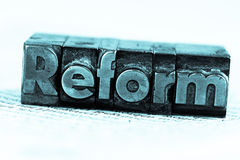 Written reform in lead letters Stock Photos