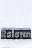 Written reform in lead letters Royalty Free Stock Images