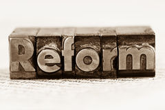 Written reform in lead letters. The word reform in lead letters written. photo icon for quick correspondence Stock Photography