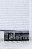 Written reform in lead letters Stock Photography