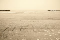 Written in the sand. Help written on the sand Royalty Free Stock Image