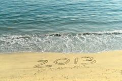 2013 written in sand. On beach Stock Photos