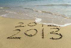 2012 and 2013 written in sand Royalty Free Stock Photos