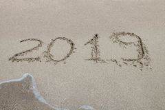 2019 written on the sand of a beach, closeup stock image