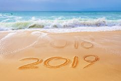 2019 written on the sand of a beach, travel new year concept. 2019 written on the sand of a beach, travel 2019 new year concept royalty free stock image