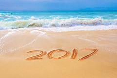 2017 written on the sand of a beach, travel  new year concept Royalty Free Stock Photos