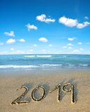 2019 written on the sand of a beach. Royalty Free Stock Image
