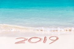 2019 written on the sand of a beach, travel new year concept. 2019 written on the sand of a beach, travel 2019 new year concept royalty free stock photo