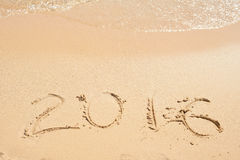 2016 written on sand. Beach and waves Royalty Free Stock Images