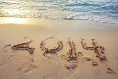2014 written on the sand. Of a beautiful beach in Emirates Royalty Free Stock Photos