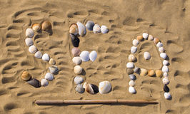 Written on sand with sea shells Stock Images