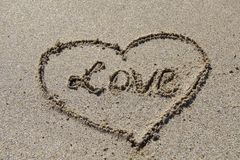 Written In The Sand. Valentine love heart drawn in the sand Royalty Free Stock Photography
