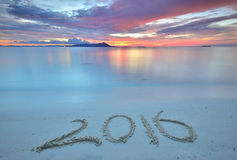2016 written on sandy beach during sunset. Royalty Free Stock Image
