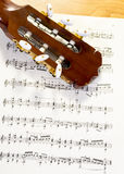 Written sheet music and a stringed instrument Royalty Free Stock Photo