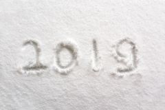 2019 written in the snow, holiday background. 2019 numbers written in the snow, holiday background stock photos
