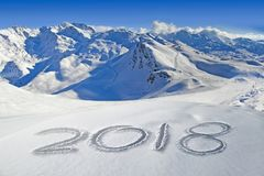 2018 written in the snow, mountain landscape in the background Royalty Free Stock Image