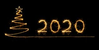 2020 written with Sparkle firework royalty free stock images