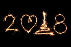 2018 written with Sparkle firework on black background, happy ne Royalty Free Stock Photography