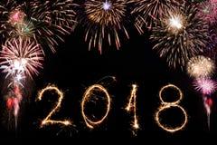 2018 written with Sparkle firework on black background, happy ne Royalty Free Stock Image
