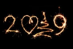 2019 written with Sparkle firework on black background, happy ne royalty free stock photos