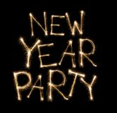 Written with sparkler firework: New year party text Royalty Free Stock Image