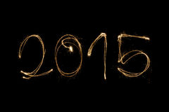 2015 written with sparkler. 2015 written with a sparkler isolated on black background Stock Images