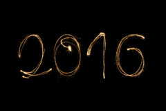 2016 written with sparkler. 2016 written with a sparkler isolated on black background Stock Illustration