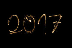 2017 written with sparkler. 2017 written with a sparkler isolated on black background Royalty Free Stock Image