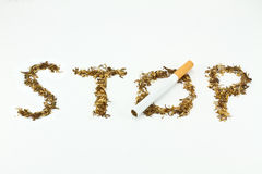 Written stop with tobacco. On white Royalty Free Stock Images