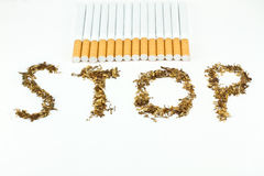 Written stop with tobacco Stock Photos