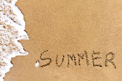 Written summer drawn on the sand Stock Image