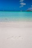 2016 written on tropical beach white sand with Stock Photo