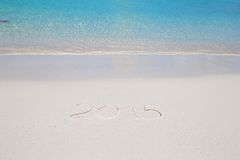 2015 written on tropical beach white sand with Royalty Free Stock Photo