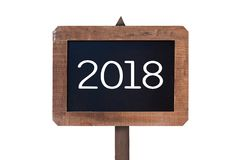 2018 written on a vintage wooden postsign isolated on white background Royalty Free Stock Photos