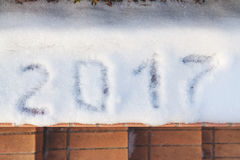 2017 is written on white snow. New year has come! 2017 is written on the white snow Stock Photo