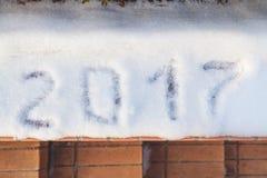 2017 is written on white snow Stock Photo