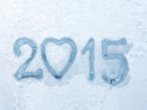 Written 2015 on winter window background. Royalty Free Stock Image