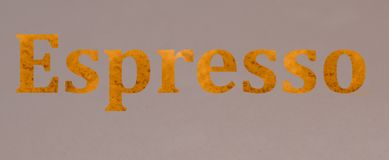 Written word Espresso. On gray background, flat lay Royalty Free Stock Image