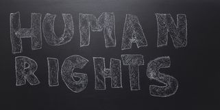 Written the word - human rights on the blackboard. stock images