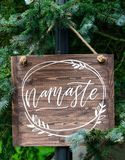 Written word namaste of wooden signboard. Close up royalty free stock image