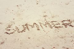 Written word summer on the beach sand Royalty Free Stock Photo