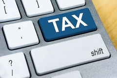 Written word TAX on blue keyboard button Royalty Free Stock Image