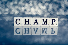Written word of tiles with letters - champ Stock Images