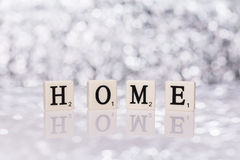 Written word tiles with letters from the game Scrabble - home Stock Photography